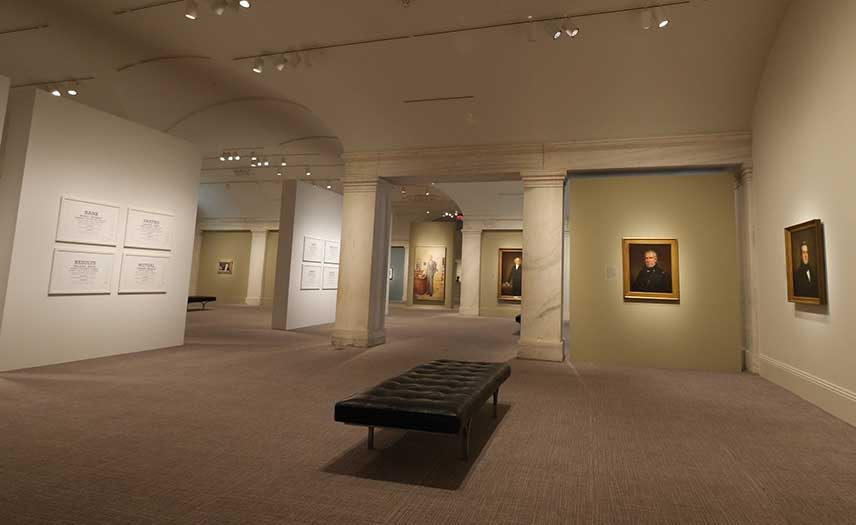 View of the exhibition, presidential portraits in the gallery