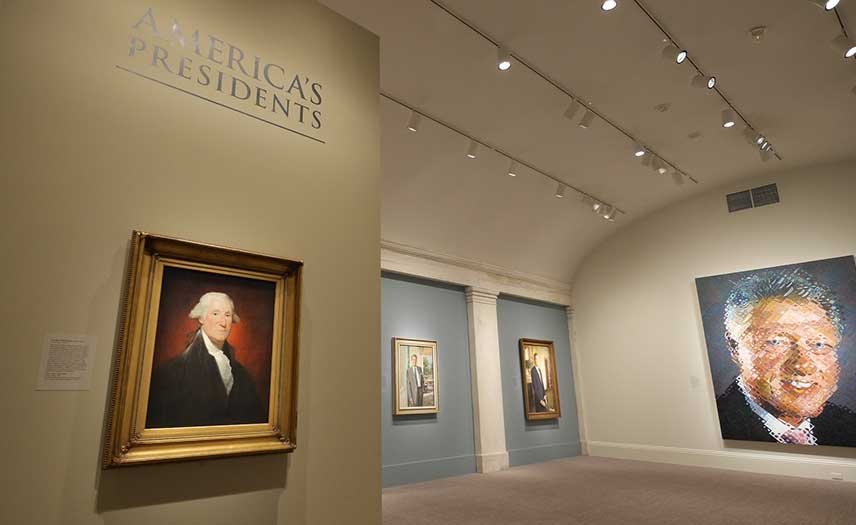 View of the exhibition entrance, with George Washington and Bill Clinton portraits