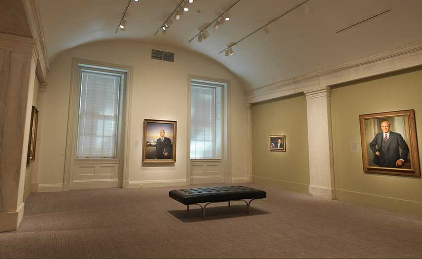 iew of the exhibition, presidential portraits in the gallery