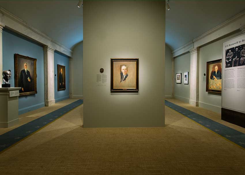 View of the exhibition, portrait of Woodrow Wilson in the center