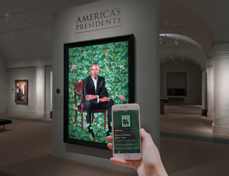 view of someone taking a photo of the Obama portrait with their phone