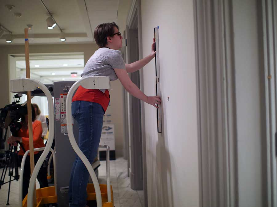 Installing signage in the Gallery