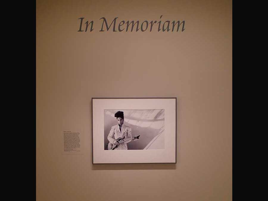 "Prince portrait on the gallery wall, underneath the text ""In Memoriam"""