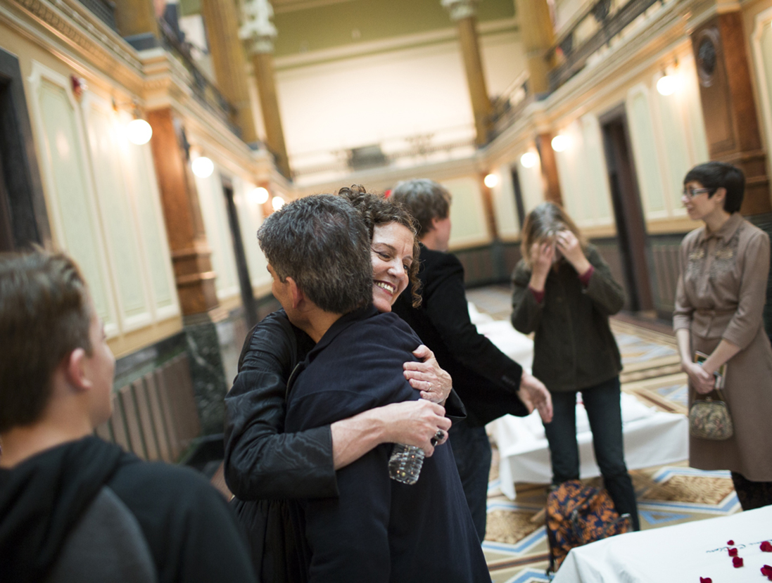 Artist hugging visiters and viewers after the performance
