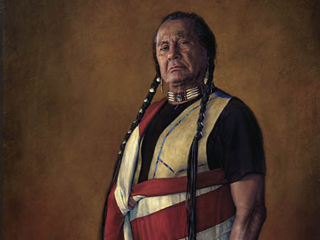 Native American man wrapped in an American flag