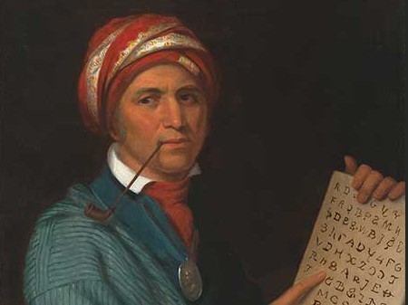 Native American man in a turban with a tablet