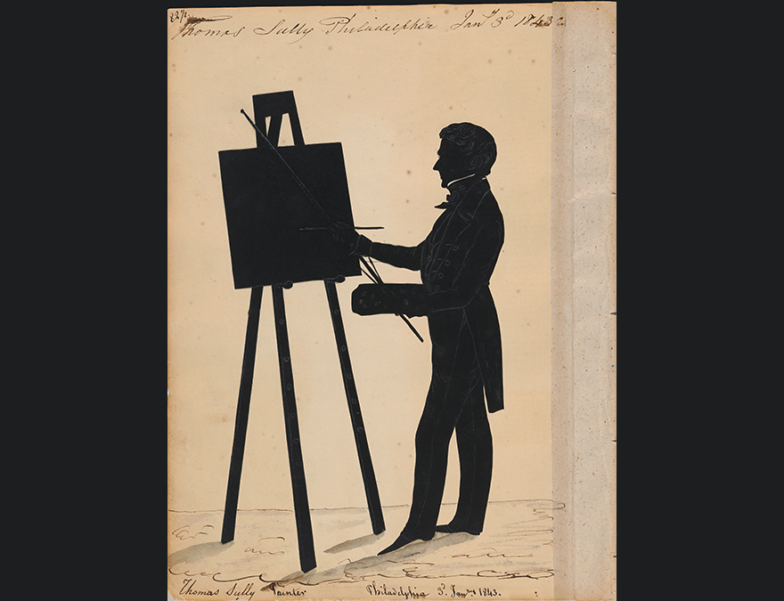 Silhouette of a man painting at an easel