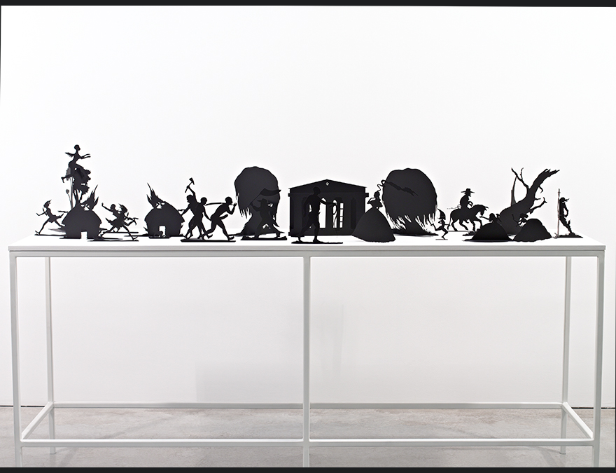 Violent scenes depicted by silhouettes on a table
