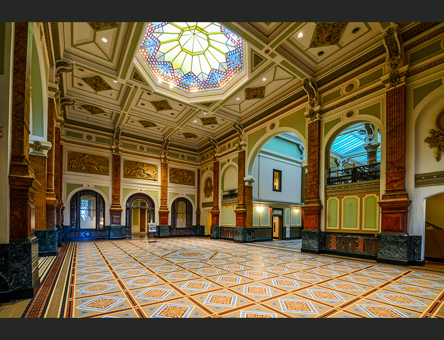 Great Hall with a tiled floor and stained glass ceiling