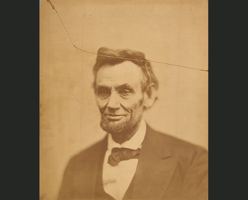 Photograph of Abraham Lincoln in a dark suit
