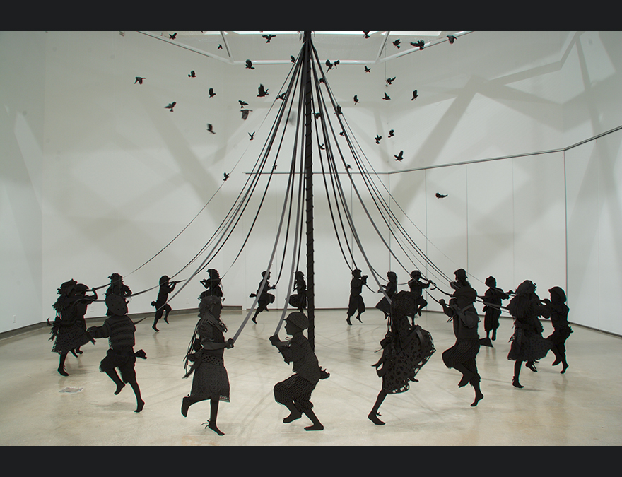 Black silhouettes of children dancing around a maypole with birds overhead