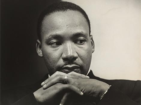 African American man with his chin resting on his crossed hands