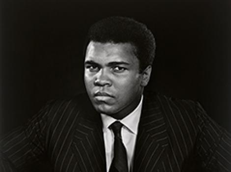 Photograph of Muhammad Ali in a suit