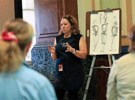 Woman teaching an art class in the gallery