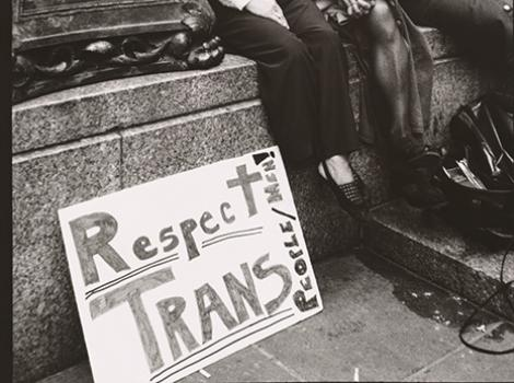 """Black and white photo of Sylvia Rivera (with Christina Hayworth and Julia Murray) with sign reading """"Respect Trans"""""""