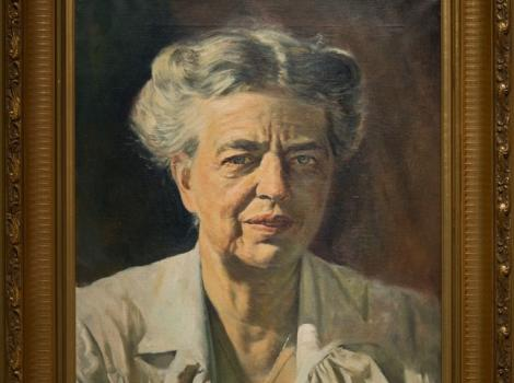 A painting of a woman with gray hear looking at the viewer