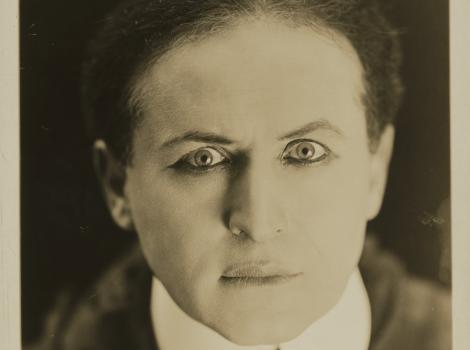 Photograph of a man staring eerily at the viewer