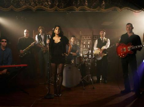 IMage of a band in spotlights, performing