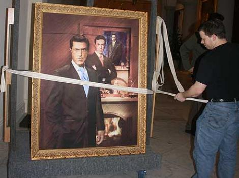 Stephen Colber's portrait being moved