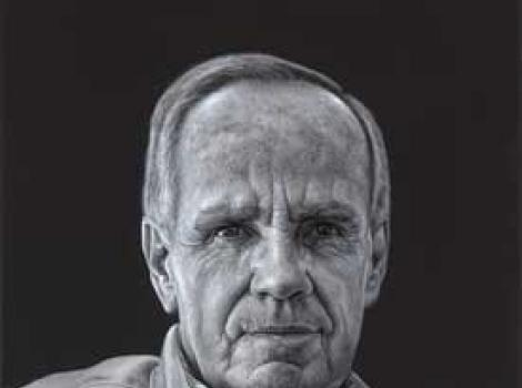 Black and white painted portrait of Cormac McCarthy