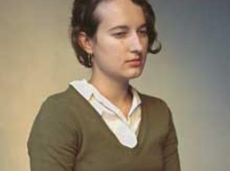 Photograph of yount woman looking sullen