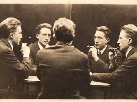 Photograph of five Marcel Duchamp's sitting around table