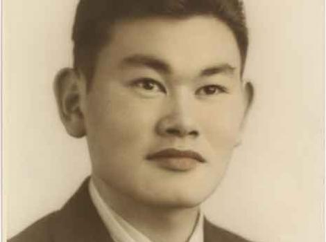 Colorized photograph portrait of Fred Korematsu in suit