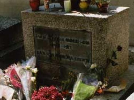 Jim Morrison's grave with flowers and candles placed by fans