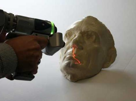 Lincoln life mask being 3d scanned with a handheld scanner