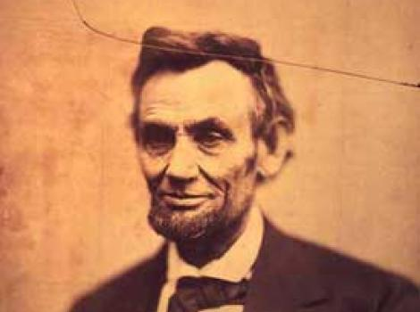 Photograph of Lincoln, crack running through top left corner and through Lincoln's hair