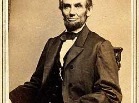 Photograph portrait of Lincoln, sitting in chair