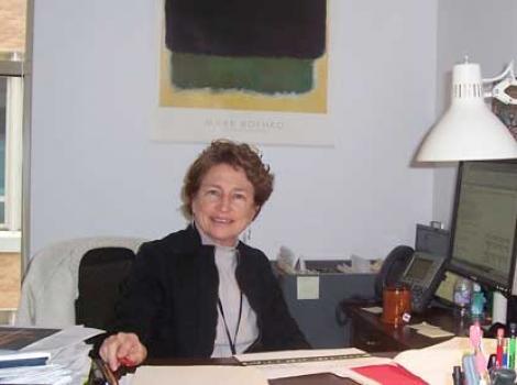 Linda Thrift, at her desk