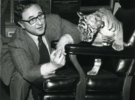 Black and white photo of Marvin Sadik with a baby tiger