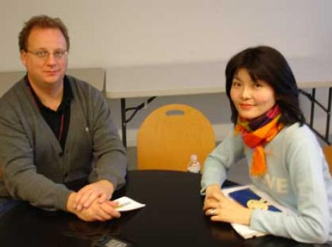 Warren Perry and Saki Tsuiki sitting at a table
