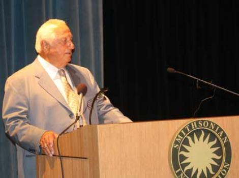 Tommy Lasorda speaking at podium
