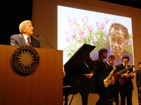 Tony Bennett at podium, speaking at the National Portrait Gallery