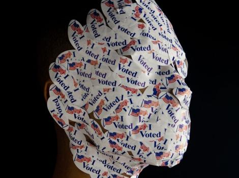"Wilmer Wilson's face covered with ""I voted"" stickers"