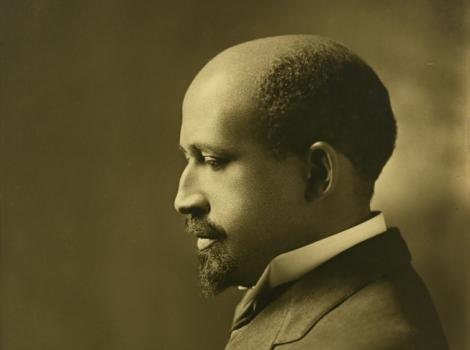 Sepia toned photograph of a man in a suit in profile