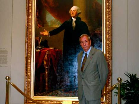 Man in front of a portrait