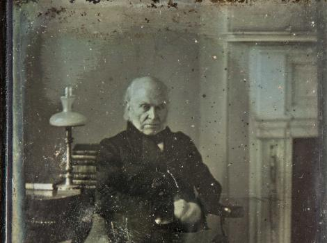 Old photograph of old man looking at the camera