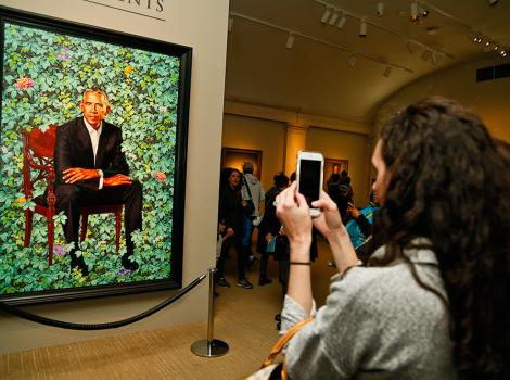 Visitor taking a photo of the Obama portrait