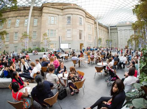 The Robert and Arlene Kogod Courtyard full of people during an event