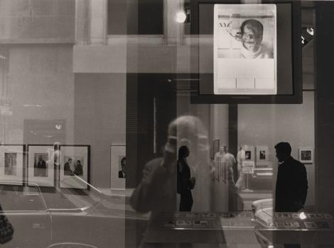 Photograph of a man photographing art in a gallery