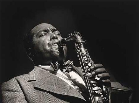 Black and white photo of Charlie Parker playing the saxophone