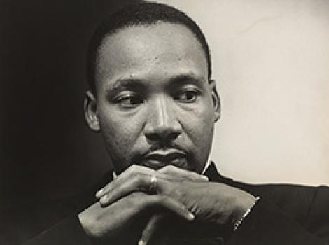 Martin Luther King Jr. with hands folded