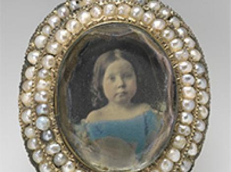 Pin with portrait of a young girl