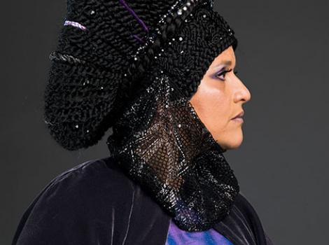 Wanda Raimundi-Ortiz in purple headress and gown