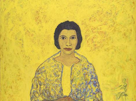 Woman in yellow against an bring yellow background