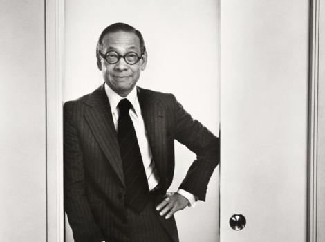 Man in a dark suit standing in a doorway