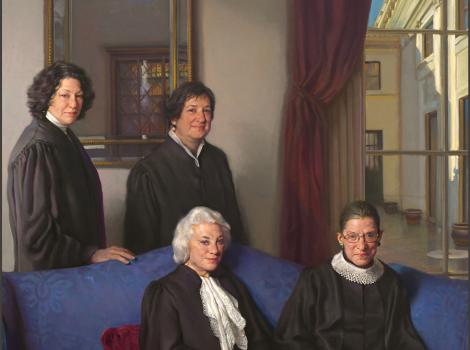 four female justices, two seated on a couch and two standing behind